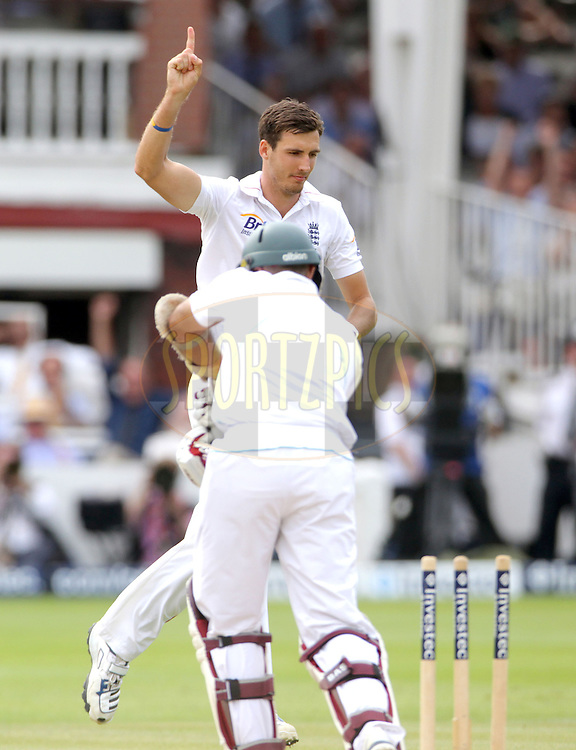 © Andrew Fosker / Seconds Left Images 2012 -England's Steven Finn (far)  celebrates the wicket of Hashim Amla (near)   bowled for 121 runs   England v South Africa - 3rd Investec Test Match - Day 4 - Lord's Cricket Ground - 19/08/2012 - London - UK - All rights reserved
