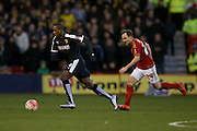 Watford forward Odion Ighalo  gets away from Nottingham Forest midfielder David Vaughan  during the The FA Cup fourth round match between Nottingham Forest and Watford at the City Ground, Nottingham, England on 30 January 2016. Photo by Simon Davies.