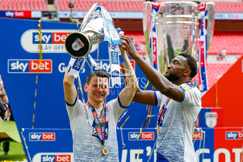 PROMOTED promotion Tranmere Rovers forward Connor Jennings (11) and Tranmere Rovers defender Emmanuel Monthe (6) hold the trophy after the EFL Sky Bet League 2 Play Off Final match between Newport County and Tranmere Rovers at Wembley Stadium, London, England on 25 May 2019.