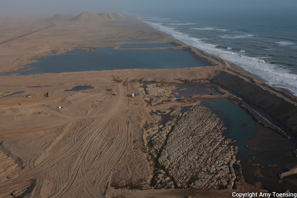 ORANJEMUND, NAMIBIA -- OCTOBER 06: Aerial views of the shipwreck site and the seawall built to keep the wreck site dry in the Namdeb diamond mine on October 06, 2008 in Oranjemund, Namibia. The wreck was discovered by miners in the Namdeb diamond mine off the coast of Namibia. The ship was found seven meters below sea level on April 1, 2008. Archeologists presume the wreck is from the early 1500s. Most of the the artifacts found are being stored in a storage shed at the Namdeb Diamond Mine. Items include: copper ingots, bronze canons, canon balls, pewter bowls and plates, ivory tusks from African elephants, and most substantial over 2000 gold coins- approximately 21 kg - the most gold found in Africa since the Valley of the Kings in Egypt. (Photo by Amy Toensing) _________________________________<br />