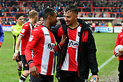 Kyle Edwards (28) of Exeter City and Kane Wilson (22) of Exeter City leave the field smiling at full time after a 3-1 win over Swindon Town during the EFL Sky Bet League 2 match between Exeter City and Swindon Town at St James' Park, Exeter, England on 24 March 2018. Picture by Graham Hunt.