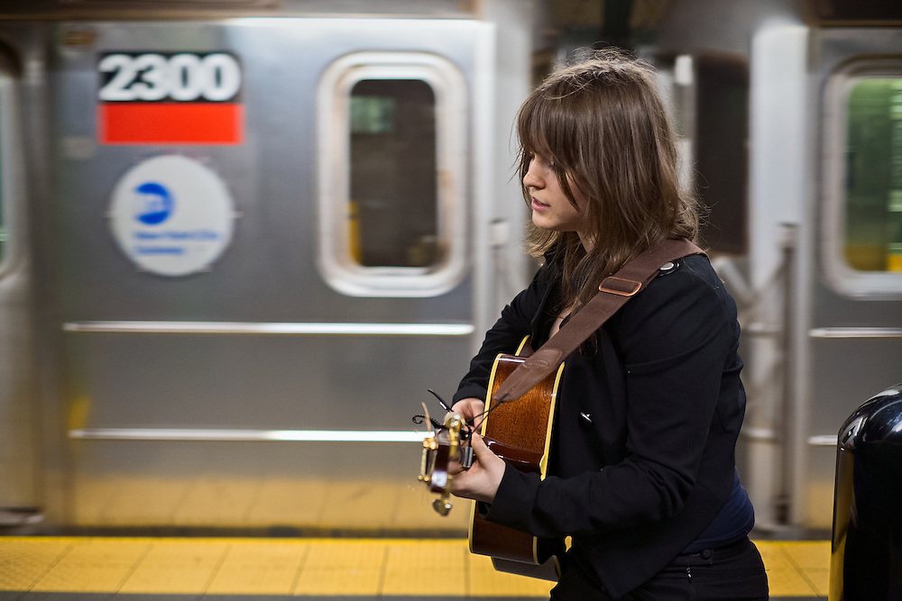 Singer Molly Ruth performing on the 1,2,3 platform in Times Square station, New York, NY