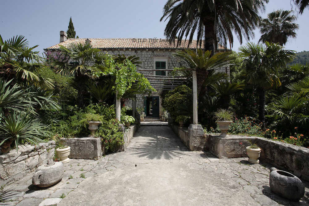 Restored villa and mill of the Croatia Academy of Arts and Sciences, in the grounds of the Trsteno Arboretum, a preserved Renaissance garden.  Seaside facade and parts of the garden in view.  Villa originally the family summer home of Nicolò Vito Gozze (1549-1610).