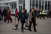 2 ladies working with vacuum cleaners, Ladies Day, Cheltenham Festival, 13 March 2019