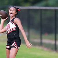 Thomas Wells | BUY at PHOTOS.DJOURNAL.COM<br /> Corinth cheerleader Ziona Cummings, 14, tries her arm out before they play Ripley.