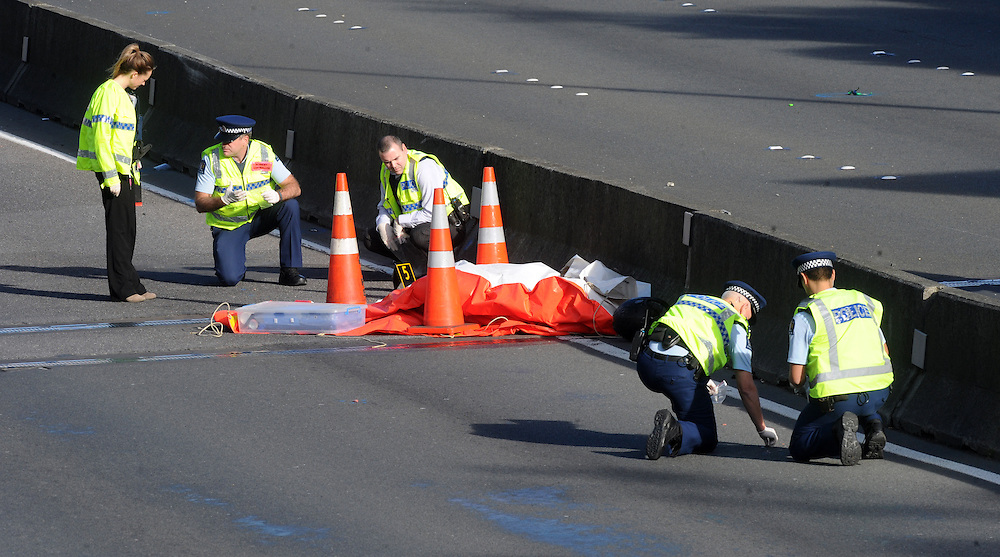 Two people are dead after a motorcyle collided with the median barrier on the north bound lane of the motorway near the Terrace Tunnel, Wellington, New Zealand, Sunday, June 28, 2015. Credit:SNPA / Ross Setford