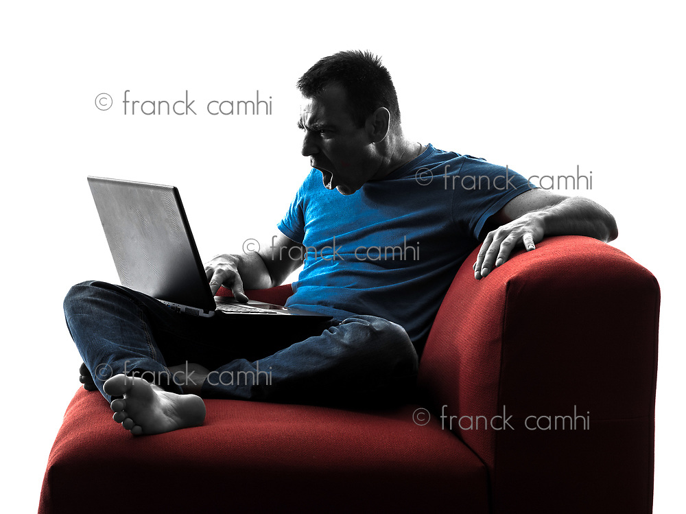 one caucasian man sofa couch computer computing laptop angry screaming in silhouette isolated on white background