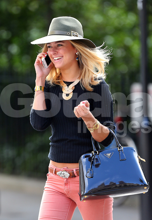 Made In Chelsea star Kimberley Garner wearing a stylish green hat, black jumper, tight skinny pink jeans and bron ankle boots out running errands in Chelsea, London, UK. 18/09/2013<br />