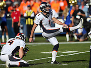 Denver Broncos punter Britton Colquitt (4) holds while Denver Broncos kicker Connor Barth (1) kicks a first quarter field goal for a 3-0 lead during the NFL week 15 regular season football game against the San Diego Chargers on Sunday, Dec. 14, 2014 in San Diego. The Broncos won the game 22-10. ©Paul Anthony Spinelli