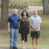 Pete Larkin, left, Catherine Milioti, center, and Clark Milioti pose for a photo Monday November 2, 2015 at Sunset Beach Park in Sunset Beach, N.C. (Jason A. Frizzelle)