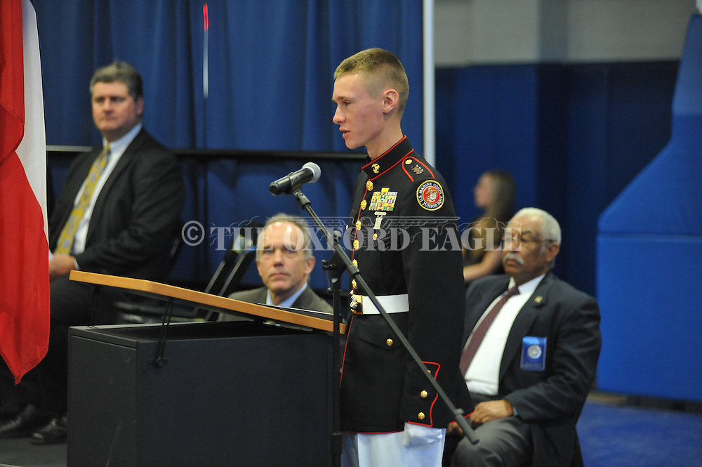Zach Hatcher reads the Preamble and the 1st Amendment during a Naturalization Ceremony in U.S. District Court for the Northern District of Mississippi, at Oxford High School in Oxford, Miss. on Tuesday, November 18, 2014. The ceremony was the first the court has ever held at the school.