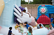 Children play on an Epicurean inflatable character during the 4th annual Yum Yum Fest held at Breese Stevens Field, Sunday, August 6, 2017.