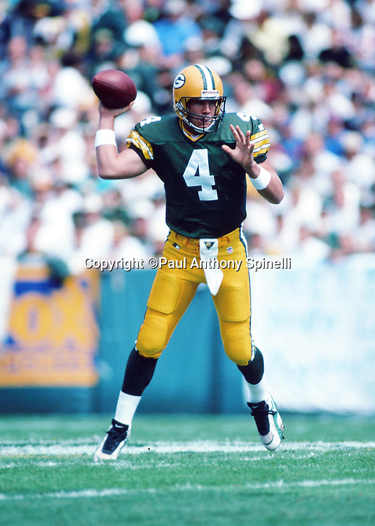 Green Bay Packers quarterback Brett Favre (4) throws a pass during the NFL football game against the New York Giants on Sept. 17, 1995 in Green Bay, Wis. The Packers won the game 14-6. (©Paul Anthony Spinelli)