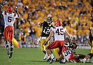 08 SEPTEMBER 2007: Iowa quarterback Ricky Stanzi (12) has his pass batted by Syracuse free safety Joe Fields (5) in Iowa's 35-0 win over Syracuse at Kinnick Stadium in Iowa City, Iowa on September 8, 2007.