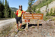 BC00640-00...MONTANA -  Tom Kirkendall at the Whitefish Divide along Forest Service Road 114 section of the Great Divide Mountain Bike Route.