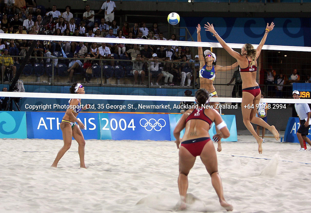 USA's Misty May and Kerri Walsh and Brazil's Adriana Behar and Shelda Bede during the womens beach volleyball gold medal match between Brazil and the USA at the Faliro Coastal Zone Olympic Complex, 24 August 2004, Athens, Greece<br />