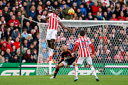 Mame Biram Diouf of Stoke City clears from Chris Smalling of Manchester United - Mandatory byline: Rogan Thomson/JMP - 26/12/2015 - FOOTBALL - Britannia Stadium - Stoke, England - Stoke City v Manchester United - Barclays Premier League - Boxing Day Fixture.