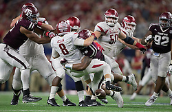 Texas A&M's defensive lineman Daeshon Hall (10) knocks the ball loose from Arkansas' quarterback Austin Allen (8) during the fourth quarter of an NCAA college football game Saturday, Sept. 24, 2016, in Arlington, Texas. (The Eagle/Sam Craft)