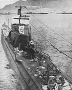 Italian submarine 'Galileo Galilei' flying the White Ensign after capture off Aden by the British Admiralty trawler 'Moonstone' on 19 June 1940.  Depth charges forced submarine to the surface and crew was forced to surrender.