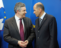 Gordon Brown, the UK's prime minister, left, is greeted by Janez Jansa, Slovenia's prime minister and standing president of the European Council, at the European Summit, in Brussels, Belgium on Thursday, June 19, 2008. PHOTO © JOCK FISTICK