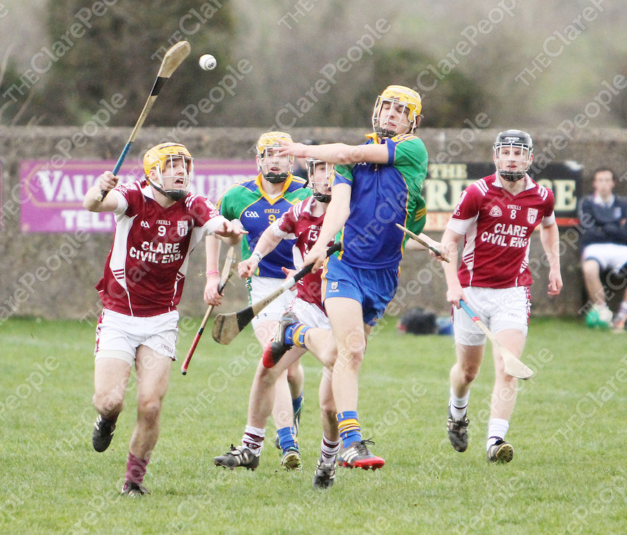 8/3/14 Feakle-Kilanena's Jarlaith Colleran hand passed the sliotar away against St Josephs Doora-Barefield in Tulla at the weekend . Pic Tony Grehan / Press 22