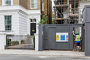 """London, England, UK, June 5 2018 - Construction work in houses of Tregunter Road in the Chelsea area, one of the richest residential neighborhood in London. Due to strict regulations on the height of the buildings and high cost of housing, honeowners burrow down to build or extend basements. Even though the Royal Borough of Kensington and Chelsea have restricted the digging to one floor underground, they allow to dig as low as 17meters under the ground level and create split """"levels"""". Tregunter Road is the street with the highest permit in Chelsea for basement digging."""