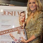 NLD/Amsterdam/20110124 - Josh V VIP Launch Modefabriek RAI, Josh Veldhuizen met de cover van haar Lookbook