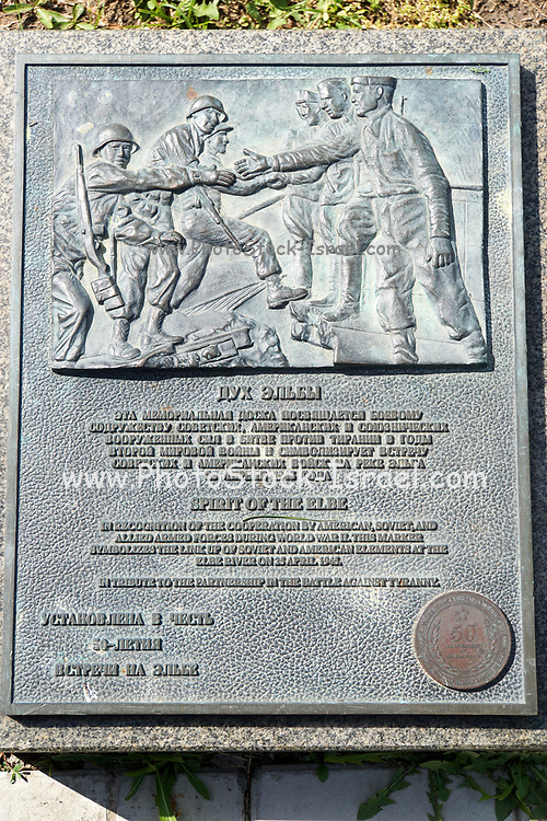 A plaque commemorating the meeting of Soviet and American soldiers at the river Elbe near Torgau in Germany, in 1945. Photographed at the Museum of the Great Patriotic War, Park Pobedy (Victory Park), Moscow, Russiaat