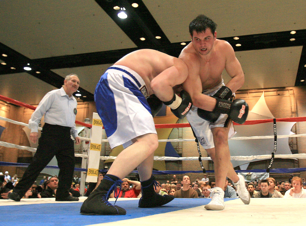 Mar. 6, 2007; South Bend, IN, USA; Former Notre Dame Fighting Irish football player Tom Zbikowski (white trunks) fights Ryan St. Germain (blue trunks) in an exhibition bout at the Century Center in South Bend, Indiana. Mandatory Credit: Matt Cashore-US PRESSWIRE