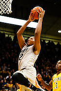 November 13th, 2013:  Colorado Buffaloes sophomore forward Xavier Johnson (2) elevates to the rim for a dunk in the first half of action in the NCAA Basketball game between the University of Wyoming Cowboys and the University of Colorado Buffaloes at the Coors Events Center in Boulder, Colorado