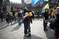 © Licensed to London News Pictures. 18/04/2019. London, UK. Emotional campaigners arriving to join the protest embrace each other as Extinction Rebellion occupy Parliament Square for a fourth day. Protesters are demanding urgent government action on climate change. Photo credit: Ben Cawthra/LNP