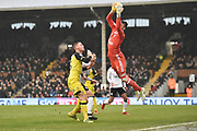 Fulham goalkeeper Marcus Bettinelli (1) saves from Burton Albion defender Tom Naylor (15) during the EFL Sky Bet Championship match between Fulham and Burton Albion at Craven Cottage, London, England on 20 January 2018. Photo by Richard Holmes.