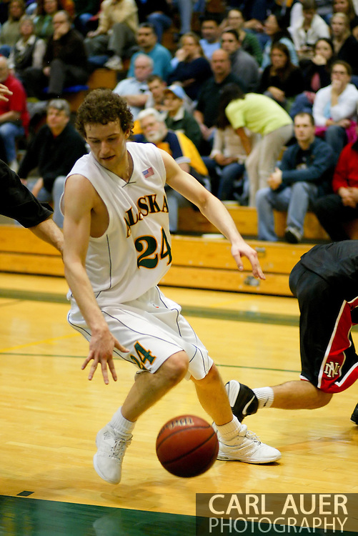 1/13/2006: Sophomore forward Ivan Platenik (24) of the UAA Seawolves heads to the hoop in the Alaska Anchorage comeback victory over Northwest Nazarene, 60-57, in men?s basketball action at the Wells Fargo Sports Complex on Saturday.