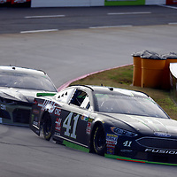 Kurt Busch (41) races through turn three to practice  for the First Data 500 at Martinsville Speedway in Martinsville, Virginia.
