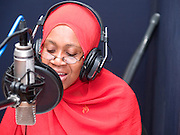 Inside the recording studio at Radio Instruction to Strengthen Education (RISE) project. VSO volunteer teacher trainer, Daphne Sharpe helps to write programmes to teach Tanzanian children literacy, numeracy, HIV/AIDS prevention, and life skills related to health, hygiene, and nutrition via interactive radio instruction (IRI). Lessons are broadcast over Tanzania's national radio station network, and trained on-site education mentors lead children through the lessons using printed guides. Wind-up and solar-powered radios allow students and teachers to participate in the daily radio education programmes even in remote locations.