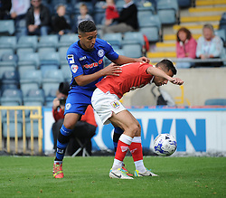 Bristol City's Sam Baldock holds the ball up against Rochdale's Bastien Hery - Photo mandatory by-line: Dougie Allward/JMP - Mobile: 07966 386802 23/08/2014 - SPORT - FOOTBALL - Manchester - Spotland Stadium - Rochdale AFC v Bristol City - Sky Bet League One