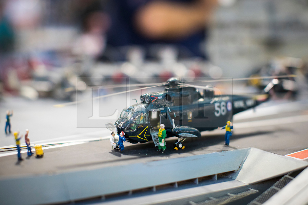 19/01/2018. London, UK. A model helicopter on the flight deck of a model of HMS Ark Royal (R09), built by Dave Fortey, at the London Model Engineering Exhibition at Alexandra Palace. Fortey, a former Royal Navy mechanic and sub-lieutenant, built the model over 25 years. It is the first time it has been put on display to the public. Photo credit: Rob Pinney