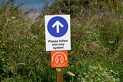 Gullane, Scotland, UK. 9 July, 2020. Signs and one-way system on beach paths have been introduced at beaches in East Lothian. To maintain social distancing some paths are one-way only. Pictured; Paths leading to and from Gullane beach are now one-way only. Iain Masterton/Alamy Live News