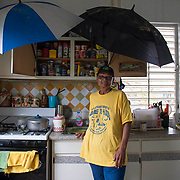 Punta Santiago, PR--Rosa Oquendo lost everything she and her husband owned during Hurricane Maria. They are now staying with their daughter and her partner. Their roof continues to leak due to extensive damage,  so Rosa installed umbrellas in their kitchen over the stove and working area. Improvization and patience are important to surviving. Photo by Lori Waselchuk/braf.org