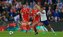 SOUTHAMPTON, ENGLAND - Friday, April 6, 2018: Wales' Charlie Estcourt and England's Nikita Parris during the FIFA Women's World Cup 2019 Qualifying Round Group 1 match between England and Wales at St. Mary's Stadium. (Pic by David Rawcliffe/Propaganda)