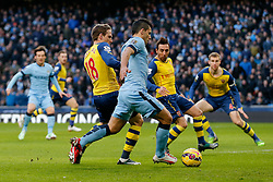 Sergio Aguero of Manchester City is challenged by Nacho Monreal of Arsenal - Photo mandatory by-line: Rogan Thomson/JMP - 07966 386802 - 18/01/2015 - SPORT - FOOTBALL - Manchester, England - Etihad Stadium - Manchester City v Arsenal - Barclays Premier League.