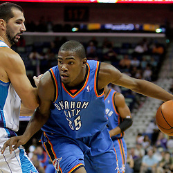 Oct 10, 2009; New Orleans, LA, USA; Oklahoma City Thunder forward Kevin Durant (35) drives past New Orleans Hornets forward Peja Stojakovic (16) during a preseason game at the New Orleans Arena. The Hornets defeated the Thunder 88-79. Mandatory Credit: Derick E. Hingle-US PRESSWIRE