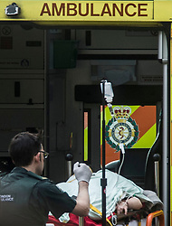 Emergency personnel treat a person on Westminster Bridge, close to the Palace of Westminster, London, after at least two people have died after a knifeman brought terror to the heart of Westminster, mowing down pedestrians then stabbing a policeman before he was shot by armed officers.
