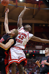 20 December 2008:  Scott Vandermeer knocks Dinma Odiakosa out of position and grabs a rebound during a game where the  Illinois State University Redbirds go to 11-0 on the season defeating the Flames of Illinois Chicago by a score of 67-60 on Doug Collins Court inside Redbird Arena on the campus of Illinois State University in Normal Illinois.