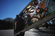 Marsh Nabors of Pearl River Glass Studio carries the stained glass window from Ventress Hall in Oxford, Miss. on Wednesday, December 1, 2010 so that it may be repaired..