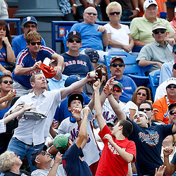 March 6, 2011; Port St. Lucie, FL, USA; Fans reach for a fly ball during a spring training exhibition game between the Boston Red Sox and New York Mets at Digital Domain Park. The Mets defeated the Red Sox 6-5.  Mandatory Credit: Derick E. Hingle