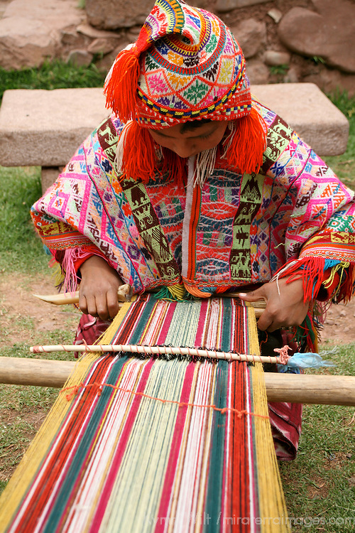 Americas, South America, Peru, Cusco. Young boy weaver at Awana Kancha.