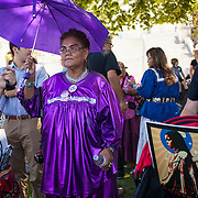 "Sandra Rambler, center, Apache, gathers with fellow members of the San Carlos Apache Tribe and their supporters in front of the United States Capitol to protest the transfer of Apache land to a private mining corporation.  In December 2014, a rider to the National Defense Authorization Act handed over Oak Flat to a private Australian-British owned company looking to mine copper.  The Apache are currently ""occupying"" Oak Flat, and travelled to D.C. to protest the action.  In response, Rep. Raul Grijalva (D-AZ-3), proposed the Save Oak Flat Act (H.R. 2811) in June, 2015 to repeal the land exchange.  John Boal Photography"