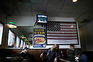 OHIO, Toledo, October 28, 2012: People are seen inside a diner in Toledo as the CNN is talking about American election. ALESSIO ROMENZI