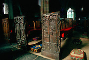 Ornate, ancient wooden carved pews and tapestry kneeling pads  in St. Keverne Parish Church in Cornwall, England